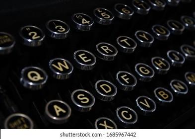 Vintage typewriter keys closeup - qwerty keyboard configuration