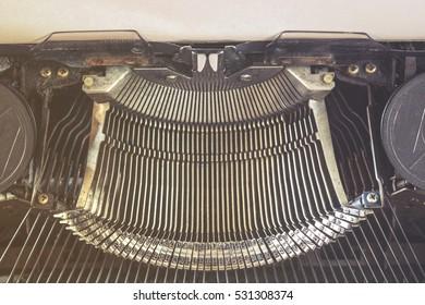 Vintage typewriter keys detail. Retro toned image with selective focus