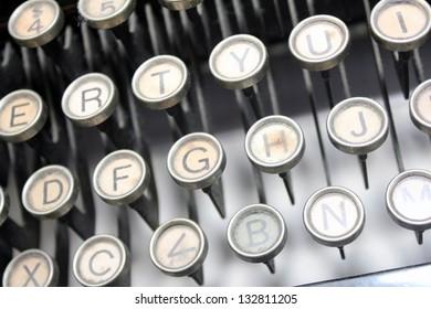 vintage typewriter keys with G in focus