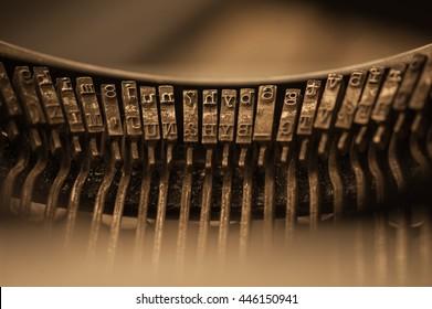 Vintage typewriter keys macro detail with blue background