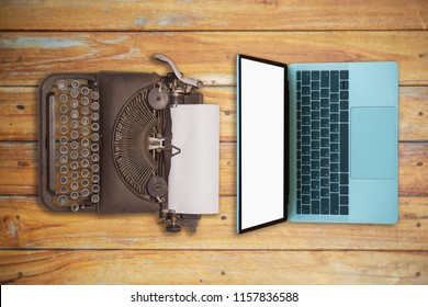 vintage typewriter and laptop on wood table