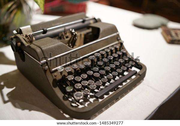 Vintage typewriter machine in a white table.