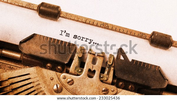 Vintage typewriter, old rusty, warm yellow filter, I'm sorry