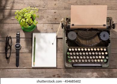 Vintage typewriter on the old wooden desk