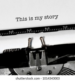 """Vintage typewriter on white background with text inspirational life quote """"what is you story"""""""