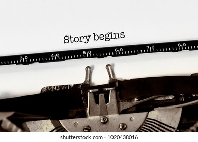 "Vintage typewriter on white background with text ""story begins"""