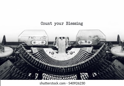Vintage typewriter on white background with text Count your Blessing.