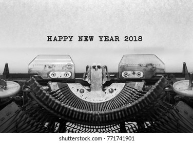 Vintage typewriter on white background with text HAPPY NEW YEAR 2018.