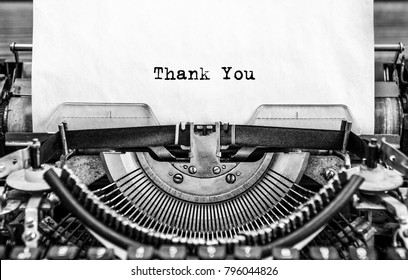 Vintage typewriter on white background with text thank you.. Close up.