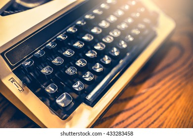 Vintage typewriter on a wood table , process in vintage style