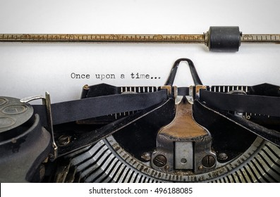 Vintage typewriter with ' Once upon a time ' typed onto white paper with copy space.