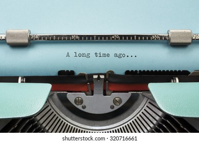 """Vintage Typewriter With Phrase """"A long time ago..."""" Typed in Blue Paper"""