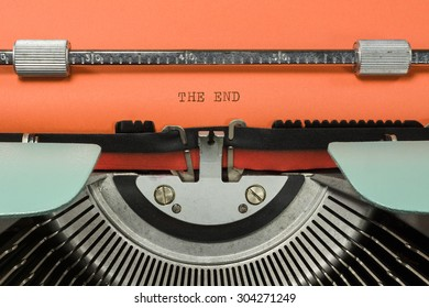 """Vintage Typewriter With Phrase """"THE END"""" Typed in Orange Paper"""
