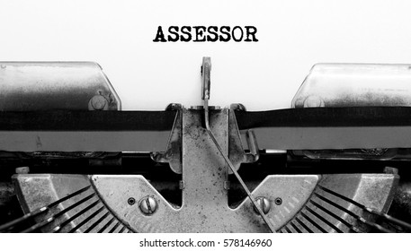 Vintage Typewriter with text ASSESSOR