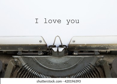 "vintage typing machine and white blank paper with word "" I love you """