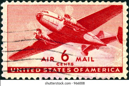 A vintage US Air Mail Stamp with an airplane, six cents.