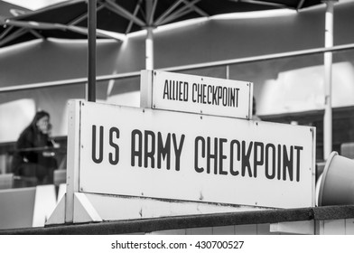 Vintage US Military, US Army Checkpoint Charlie sign in Berlin, popular tourist attraction in the German capital, travel and politics concept, cold war memorial, closeup
