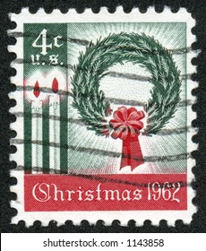 A vintage US Postage Stamp depicting a wreath and candles from 1962, Four Cents.