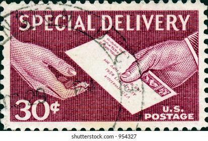 A vintage US postage stamp depicting a mailman delivering an envelope to someone.