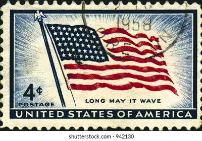 A vintage US potage stamp from the 1950's celebrating the US flag. 4 cents.