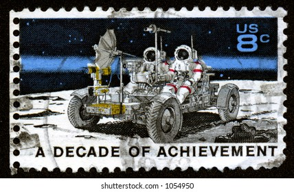 A vintage US stamp depicting the apollo mission with the moon buggy. Thirteen Cents. A decade of acheivement.