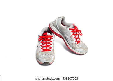 vintage used shoes on white background.Old sneakers on white.