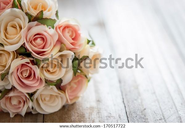 Vintage valentine flower on the wood plate