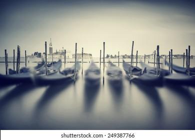 Vintage Venice cityscape , slow motion of beautiful traditional Venetian gondolas, grunge style photo, fine art photography