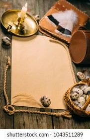 Vintage vertical mock up on rustic wood board. Candlestick, eggs inside little basket, notebook, piece of rope, and sheet of paper for text. Top view.
