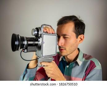 Vintage video camera. cameraman with old cinecamera. Analog technology.  Cameraman shoots a film.