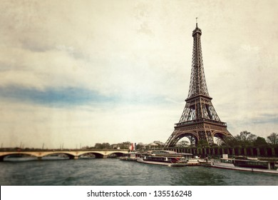 Vintage view of Eiffel tower from Seine river - Paris - France