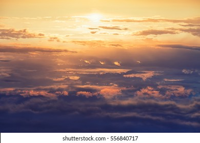 Vintage view of a sunset flying high above overcast sky