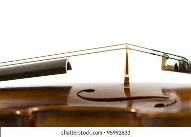 Vintage viola bridge and strings close up isolated on white background
