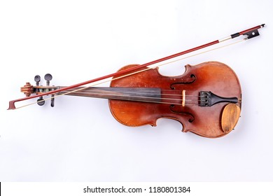 Vintage violin over white background. Retro style violin and fiddle stick. Instrument for orchestra.