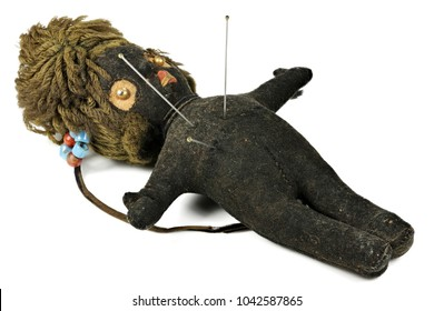 vintage voodoo doll isolated on white background