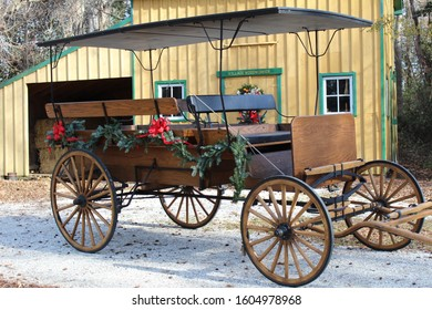 Vintage wagon in front of barn