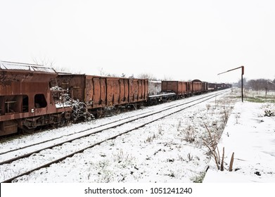 Vintage wagons on the railway in the snow in winter.