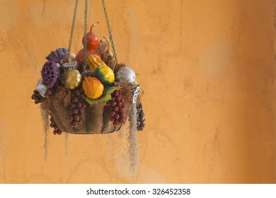 Vintage wall interior of hanging artificial fruit