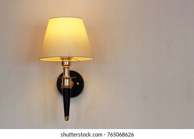 vintage wall lamp on white wall
