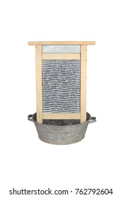 Vintage washboard in old zinc-coated tin basin isolated on white background