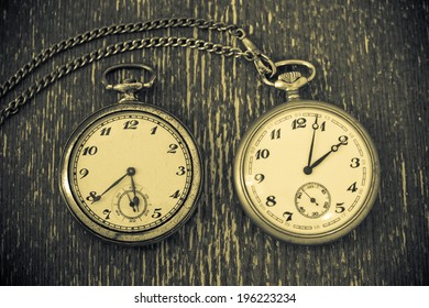 Vintage watch with chain on vintage background