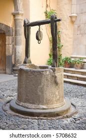 Vintage water well in a medieval village in Spain