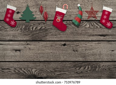 vintage weathered wooden background with cute hanging Christmas elements