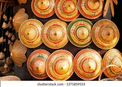 Vintage farmer's weaving hat are displays in souvenir shop, weaving hat made of palm leaves, local product of Ban Nam Chiew, Trat, Thailand.