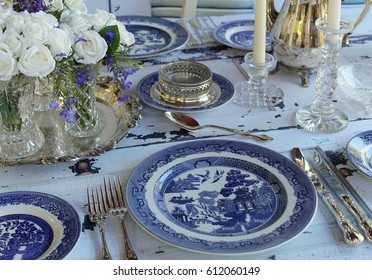 Vintage Wedding with Blue Willow Chinoiserie Dinner Plates and Cutlery on a distressed wood table