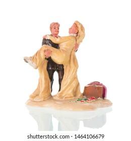 Vintage wedding cake couple figurines isolated over white background