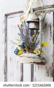 Vintage wedding decorative lantern with flowers on the door