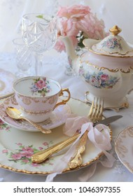 Vintage wedding place setting - blush pink dinner plate, floral tea cup, teapot gold cutlery flatware tied with ribbon and pink roses - high tea party
