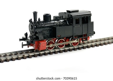 Vintage western model railway over white background