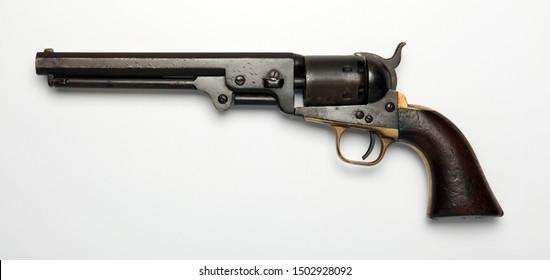 Vintage western revolver gun pointing left on white background